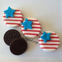 White Chocolate covered Oreo Cookies with red & blue fondant!
