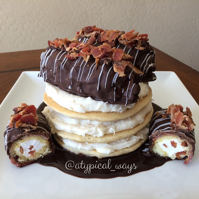 Vanilla protein pancakes layered with a thick vanilla cream filling and topped with.....wait for it.....2 bacon wrapped & deep fried Twinkies covered in two kinds of chocolate and then topped with crumbled bacon!