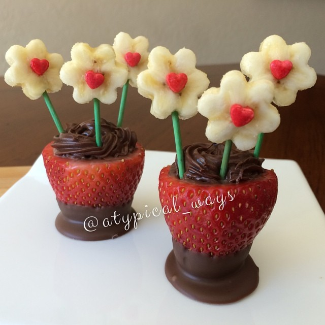 Banana Flowers sitting in Nutella stuffed Strawberry Vases