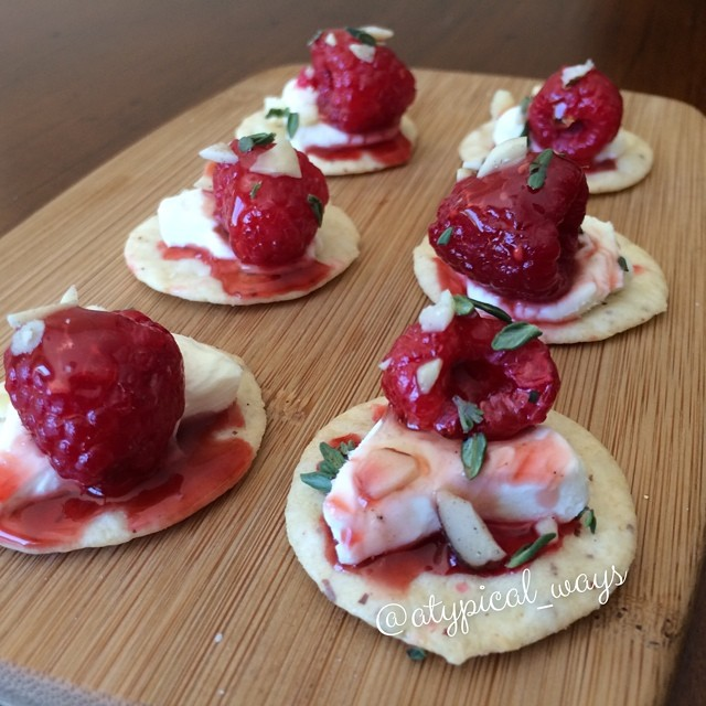 Brie cheese & nut thins topped with honeyed Raspberries, Almonds & fresh Thyme! Great little 200 calorie snack.