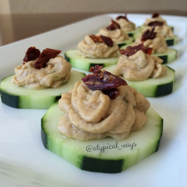 Garlic & Chive Hummus topped with sun dried tomatoes