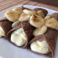 Chocolate Protein Crepes stuffed with a Banana Crème Pudding & topped with Caramelized Bananas! 335cal/33carb/5fat/37pro