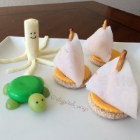 Turkey & Cheese sail boat sandwiches, Babybel & Grape turtle, String cheese octopus.